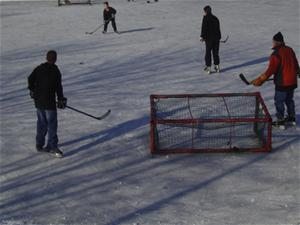 Playing ice hockey at Elm Avenue Park